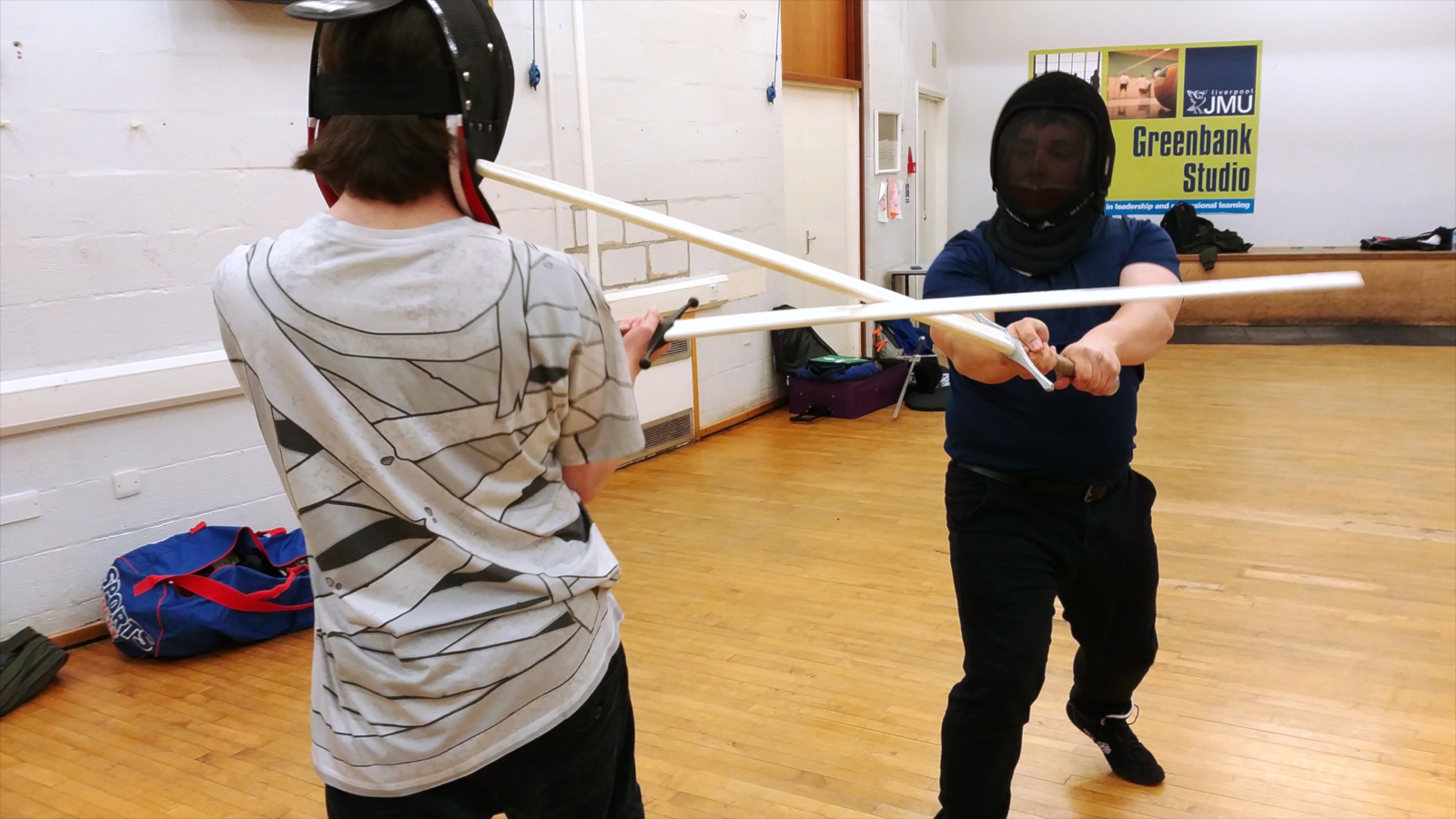 Alex making sure to cover himself as he winds his sword into his target. Photo by Keith Farrell, 2018.